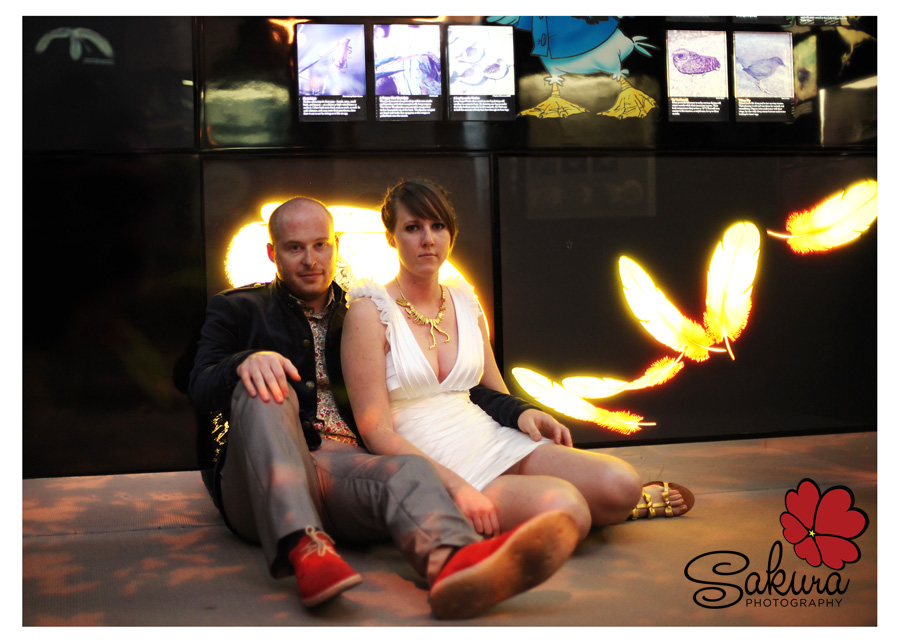 Josh & Alyssa sitting in the Natural History Museum after their wedding